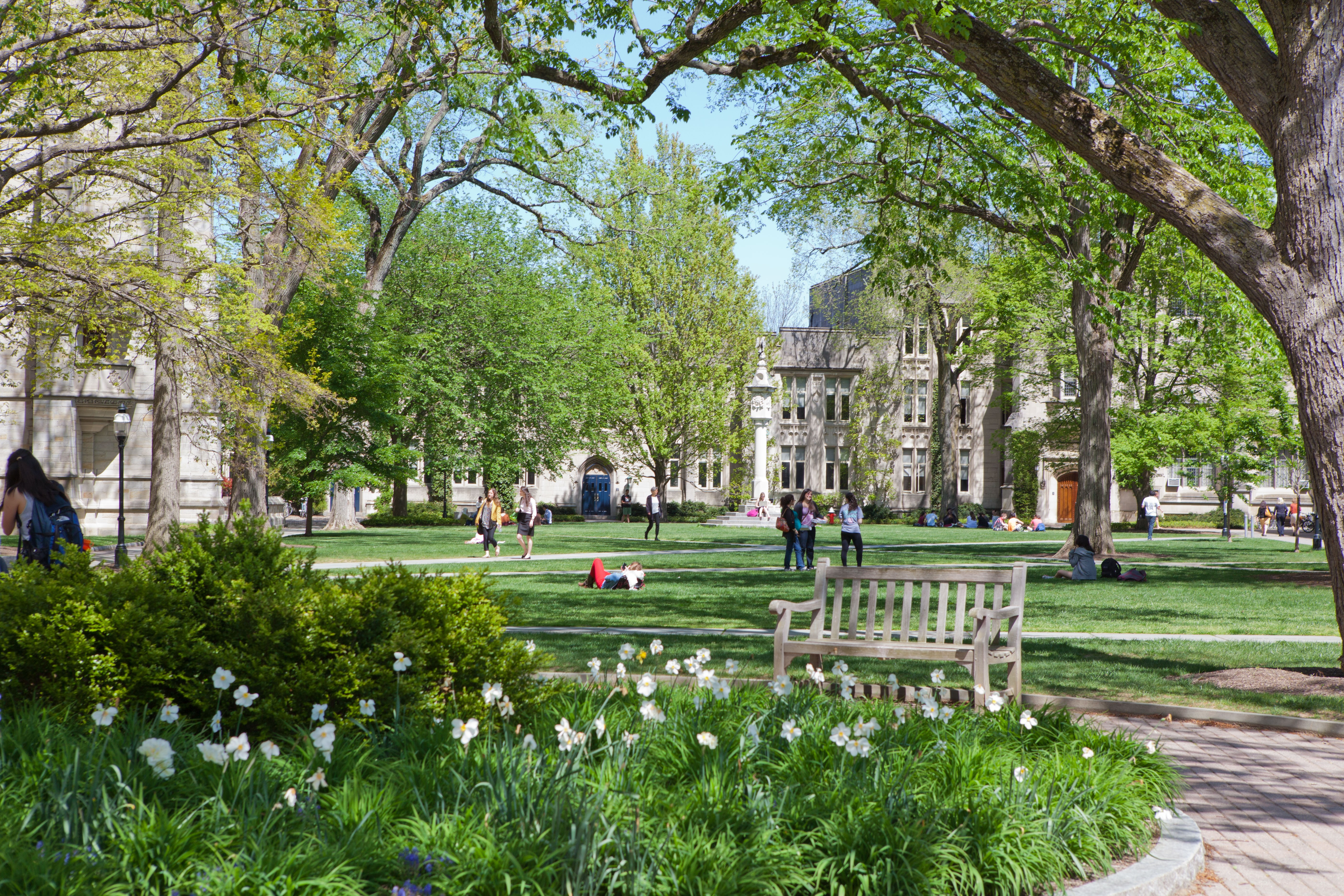 Princeton students walking and lounging during springtime at the McCosh courtyard on campus