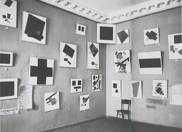 "Malevich's Black Square painting is located in the upper corner of the gallery in this photograph of the ""Last Futurist Exhibiti"