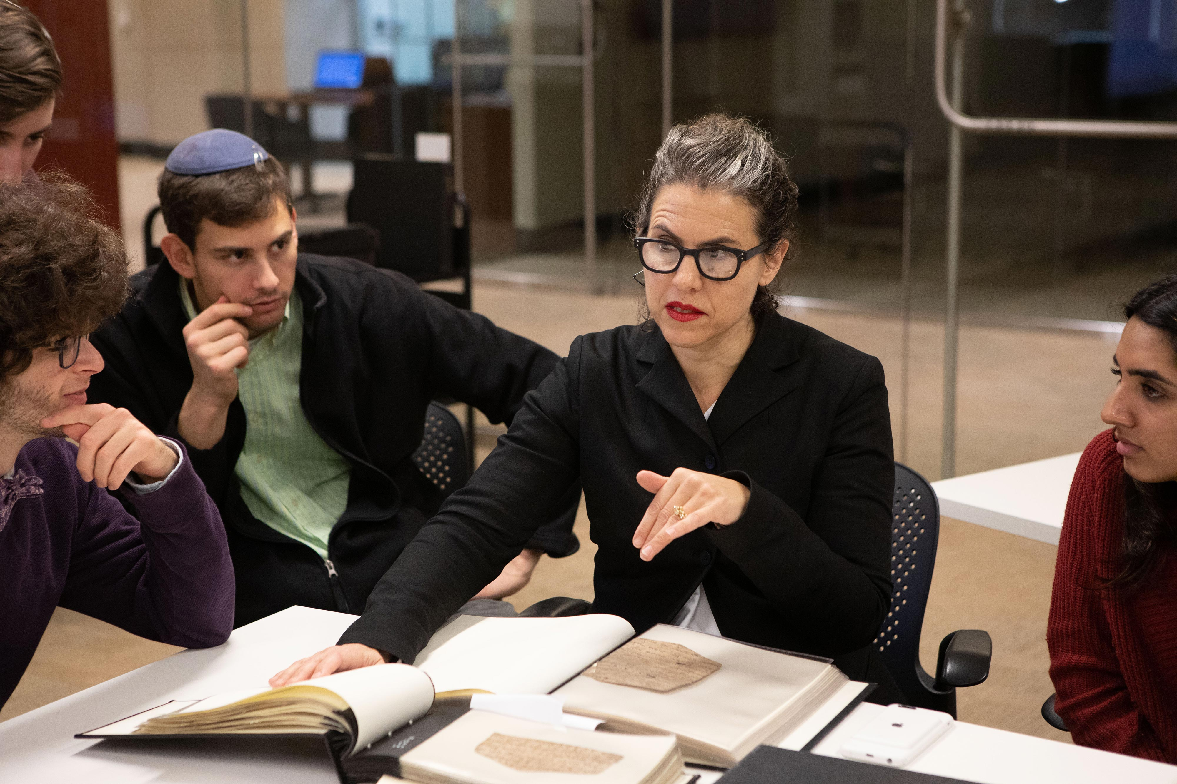 Professor examines texts from Special Collections.