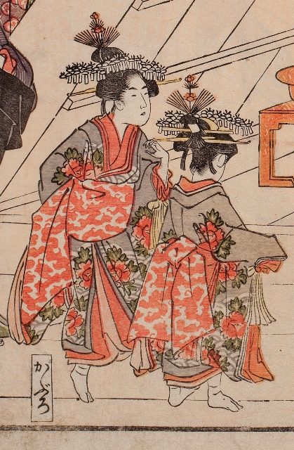 The term, furisode shinzo (long sleeve kimono), written here is the word for a teenage attendant to the oiran.