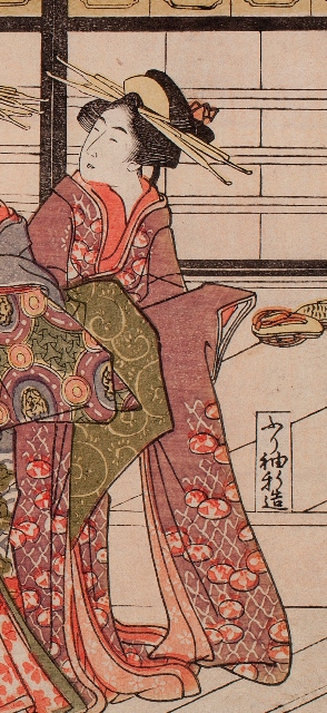 The two kamuro (child attendants) pictured  here are also attendants to the oiran. The yarite to their left is a female supervis