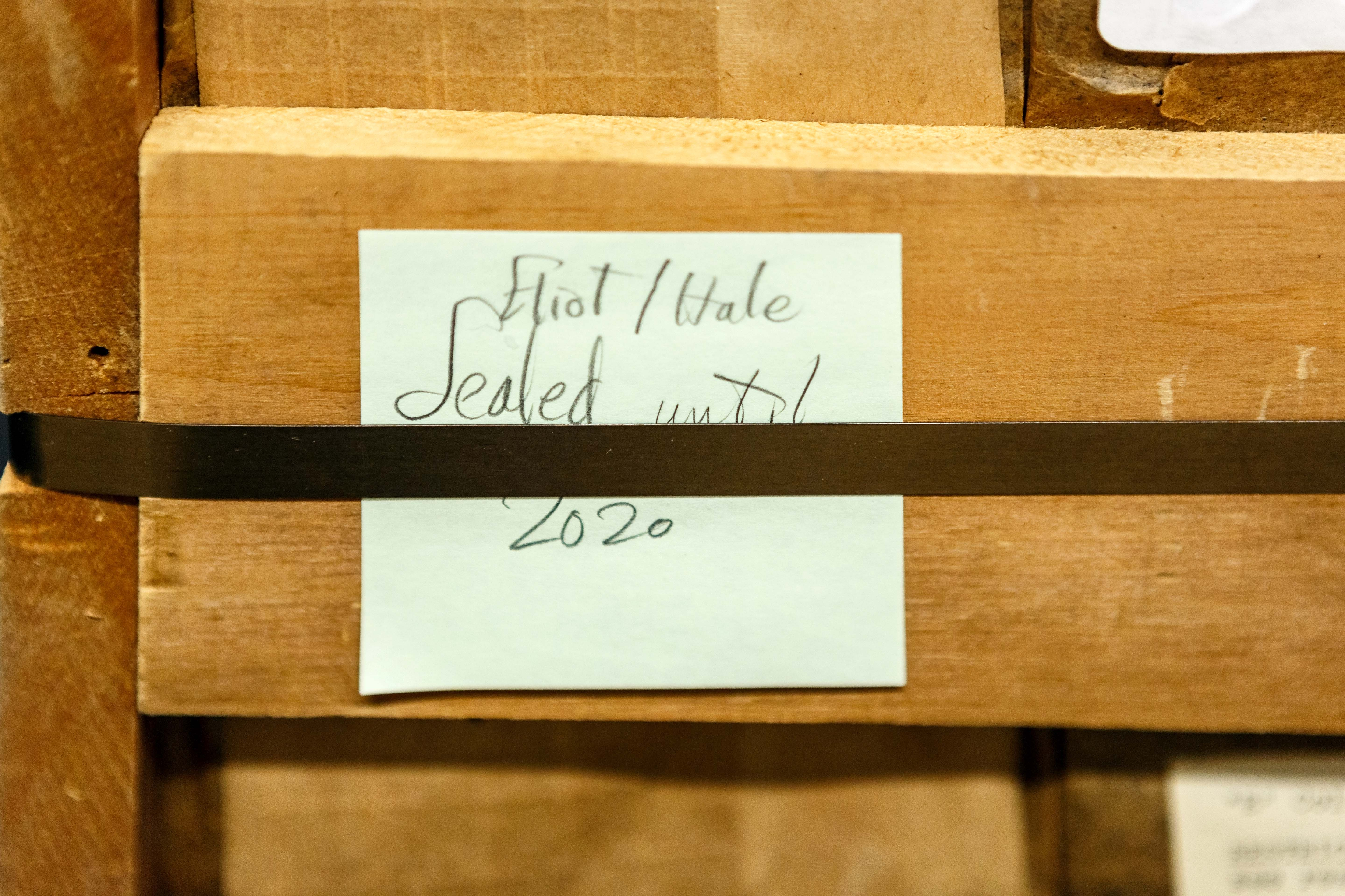 "A crate that housed the Eliot letters for over 60 years with a post-it note reading ""Eliot/Hale Sealed until 2020"""