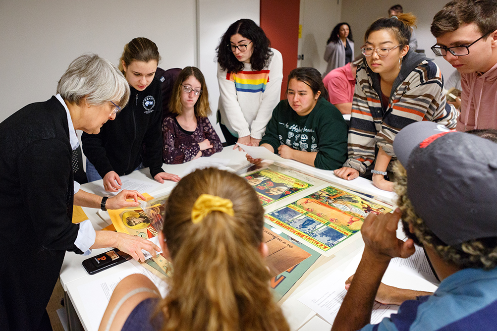 Students and professor examine materials in Special Collections
