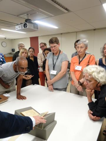 Alumni viewing materials in the Miriam Y. Holden Collection