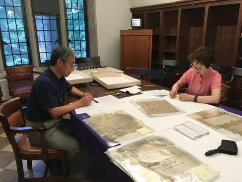 Setsuko Noguchi and Masaharu Ebara analyze documents