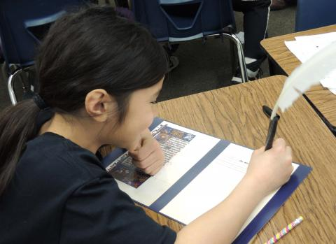 Student working with rare, primary manuscript