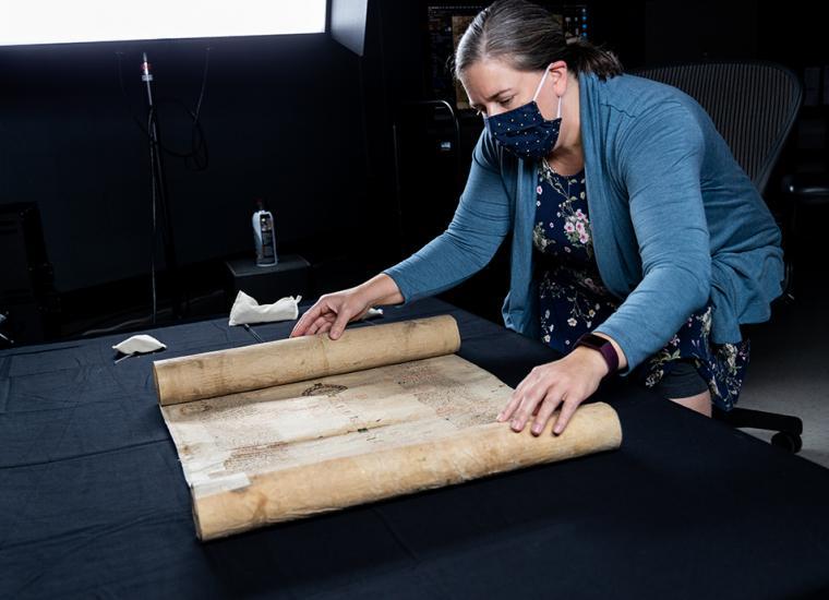 Digital Imaging Technician Beth Hass preps a scroll for digitization.