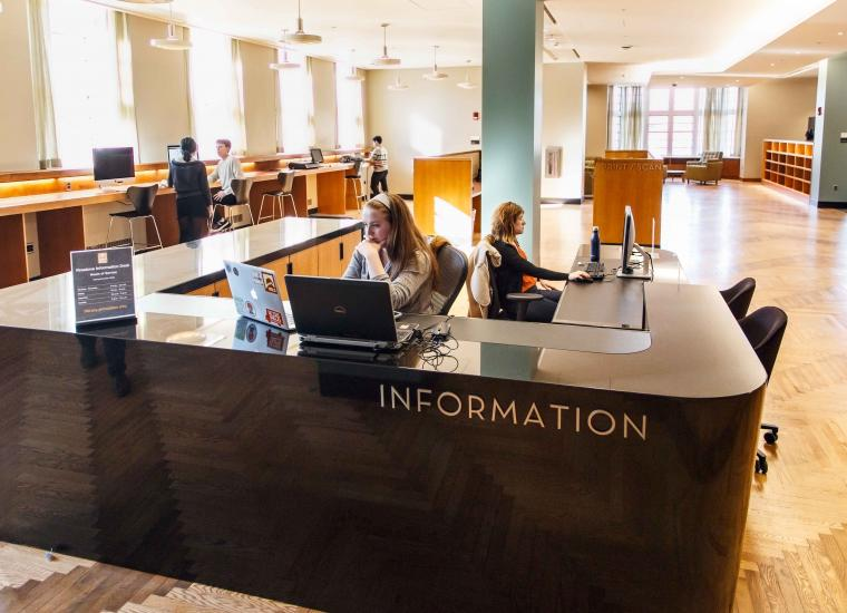 Student workers at the Information Desk in Firestone Library