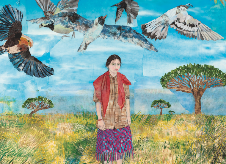 woman in fields with birds overhead