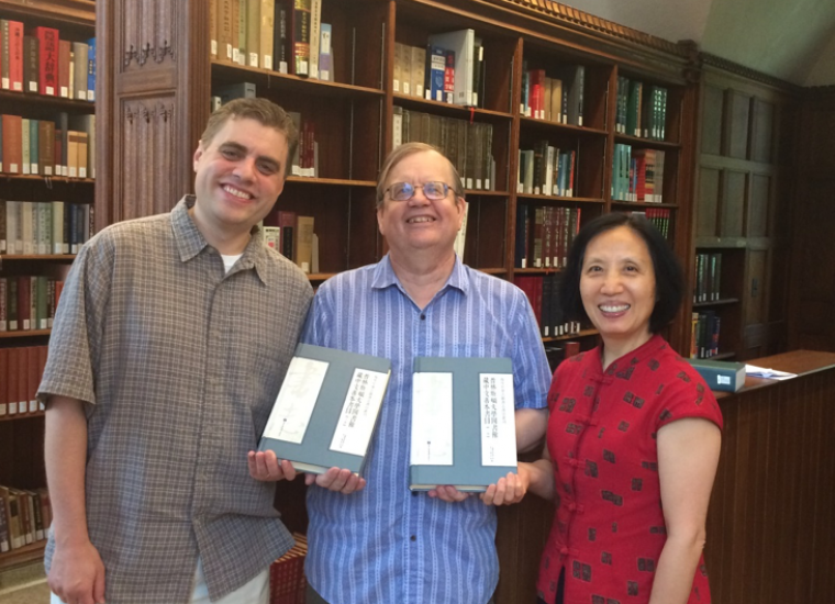 East Asian staff with recently published catalog