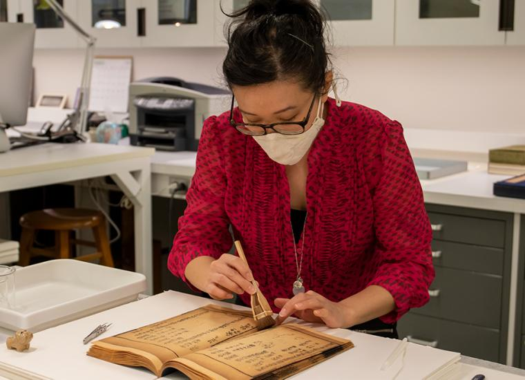 Project Conservator Victoria Wong repairs a PUL item. The Library's Preservation and Conservation Lab is among the areas in whic