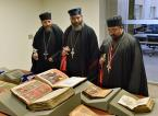 Priests view the selection of manuscripts on display.