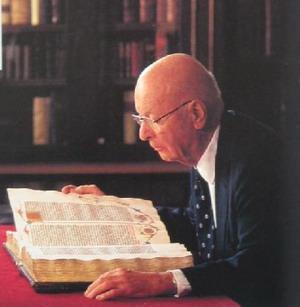 William H. Scheide examines the Gutenberg Bible.